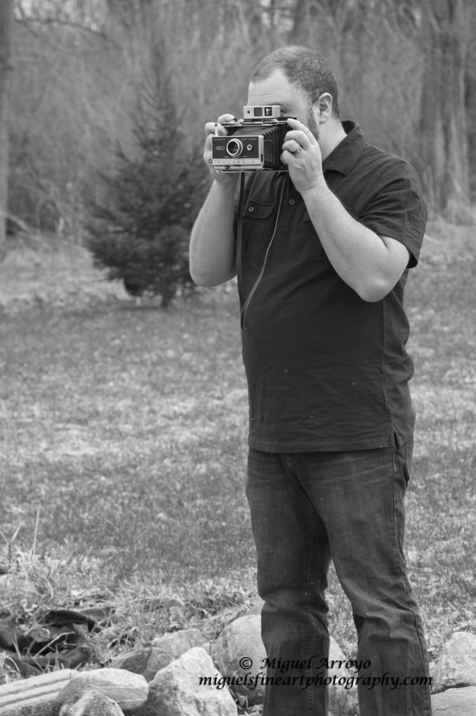 Giovanni Arroyo Shooting a Polaroid 450
